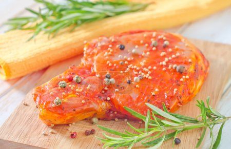 Raw steak with aroma spices
