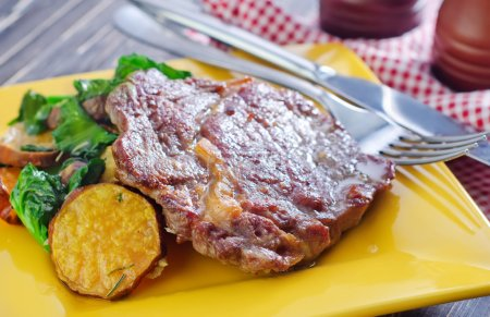 Baked meat and salad