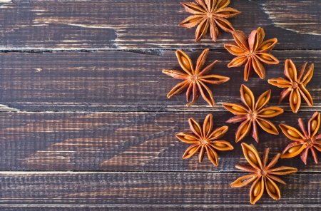 Anise on wooden board