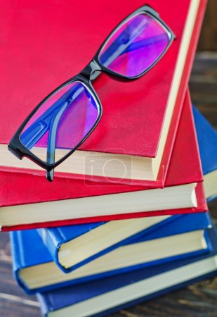Photo for Books with glasses on the table - Royalty Free Image