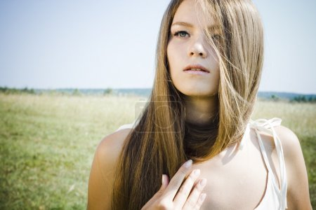 Photo for Beautiful girl with luxuriant hair outdoor - Royalty Free Image