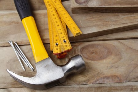 Nails, hammer and folding ruler