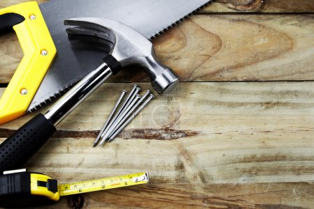 Photo for Assorted work tools on wooden planks - Royalty Free Image