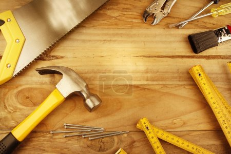 Photo for A variety of tools on wood. Advertising space - Royalty Free Image