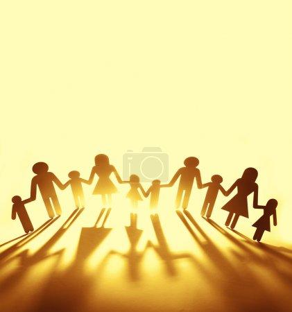 Photo pour Famille tenant la main. Espace de copie - image libre de droit