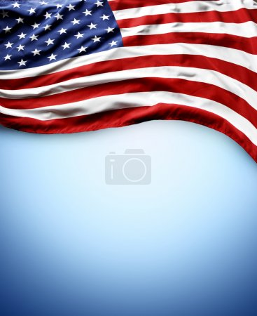 Photo for Closeup of American flag on blue background - Royalty Free Image