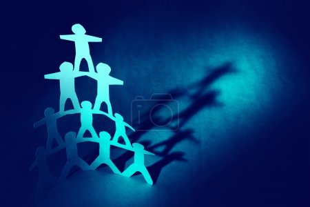 Photo for Human pyramid paper doll - Royalty Free Image