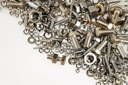 Photo for Chrome nuts and bolts closeup on plain background - Royalty Free Image