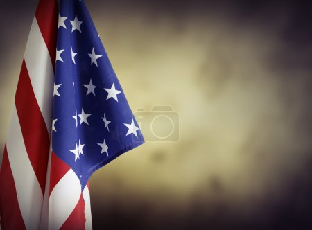 Photo for American flag in front of plain background. Advertising space - Royalty Free Image
