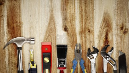 Photo for Closeup of assorted work tools on wood - Royalty Free Image
