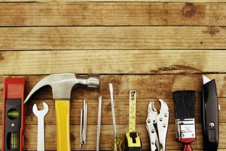 Photo for Assortment of tools on wood - Royalty Free Image