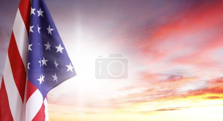 Photo for American flag in front of bright sky - Royalty Free Image
