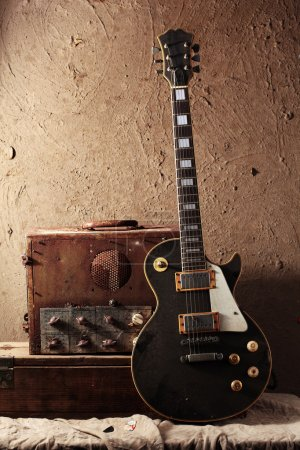 Photo for Still life art photography of vintage electric guitar and rare vintage amplifier on grunge background - Royalty Free Image