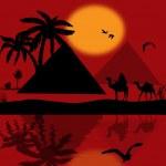 Bedouin camel caravan in wild africa landscape wit...