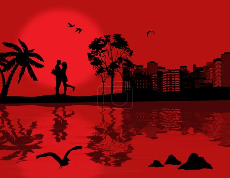 Romantic couple silhouette over red sunset