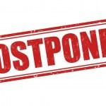 Postponed grunge rubber stamp on white background,...