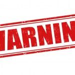 Warning grunge rubber stamp on white, vector illus...