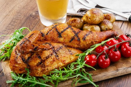 Photo for Grilled chicken with potatoes half - Royalty Free Image