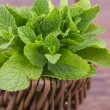 Fresh mint leaves on a wooden background...