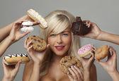 woman eating cream cakes