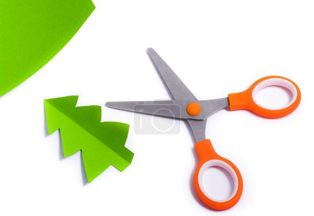 Scissors cut out fir of paper