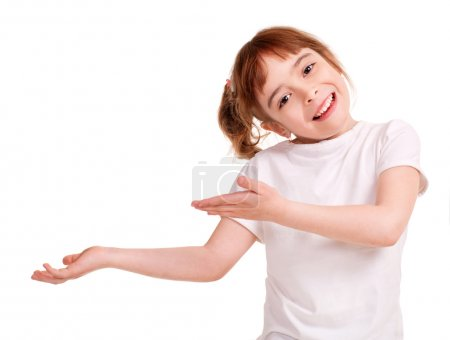 Photo for Smiling little girl showing empty hand, Isolated on white - Royalty Free Image