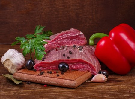 Photo for Crude meat and spice on wooden background - Royalty Free Image