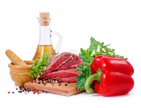 Crude meat and spice on white background