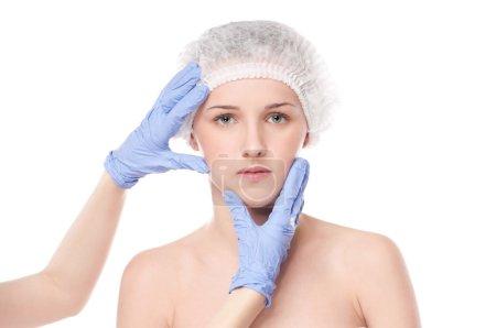 Medical face examination of beautiful woman