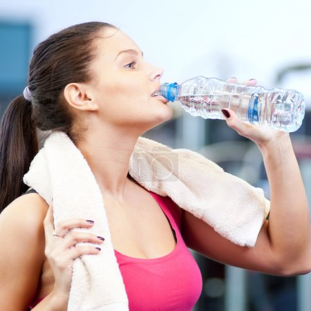 Photo for Young oman drinking water after sports. Fitness gym. - Royalty Free Image