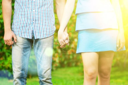 Photo for Concept shot of friendship and love of man and woman: two hands over green nature park - Royalty Free Image