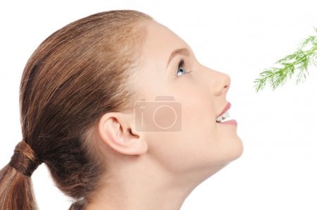 Young beauty woman with green dill