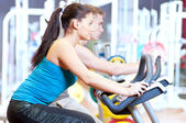 in the gym doing cardio cycling training