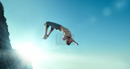Excited young man jumping in air