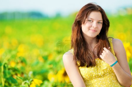 Beautiful woman in a sunflower field