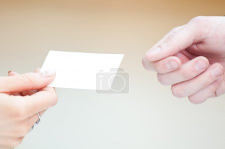 Exchange business card between man and woman.