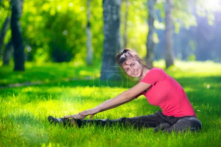 Photo for Stretching woman in outdoor sport exercise - Royalty Free Image