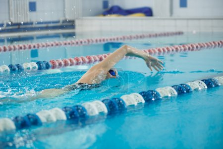 Girl swimming front crawl stroke style