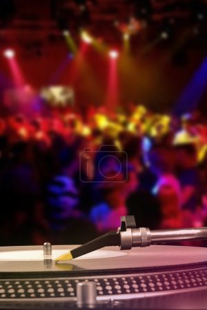 Photo for Dj turntable with vinyl record in the dance club - Royalty Free Image
