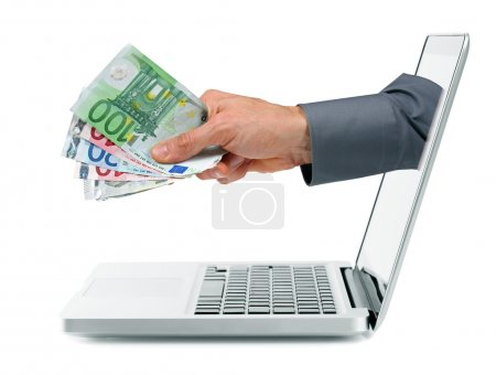 internet earnings concept - hand with money coming out from laptop screen