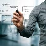 Designer drawing website development wireframe...