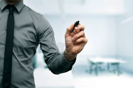 Businessman with black marker in the hand at the office