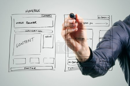 Photo for Designer drawing website development wireframe - Royalty Free Image
