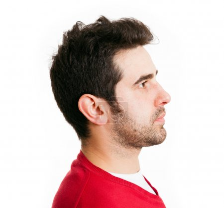 Profile view of young man in red shirt, isolated on white