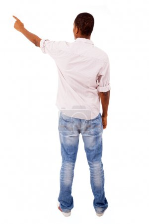 Young casual man pointing - isolated on white