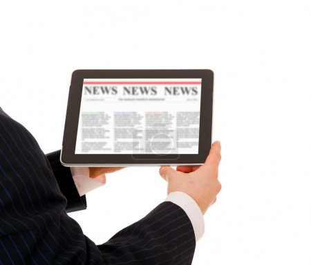 Business man holding a touchpad computer and reading the news. I