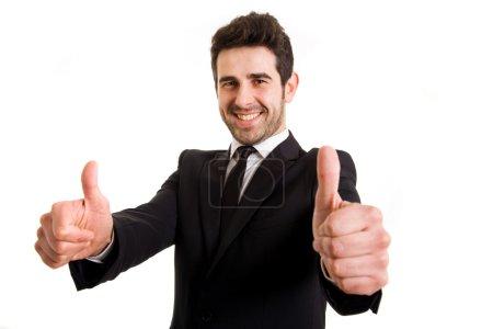 Foto de Negocio exitoso joven hombre pulgares arriba, aisladas en blanco - Imagen libre de derechos
