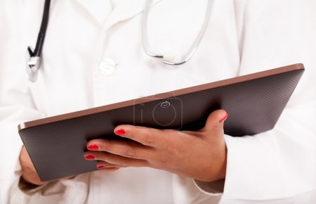 Female doctor holding a tablet computer, isolated over white bac