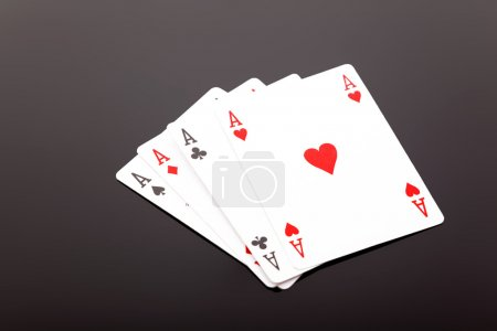 Photo pour Cartes de poker ace mis sur fond noir - image libre de droit