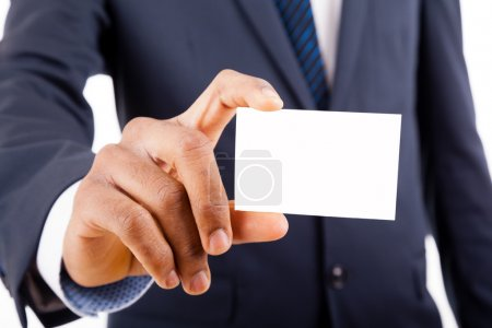 African American business man in suit showing his business card